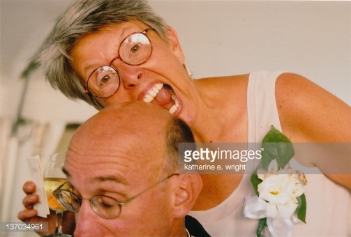 137034961-woman-take-big-bite-out-of-her-husband-bald-gettyimages.jpg